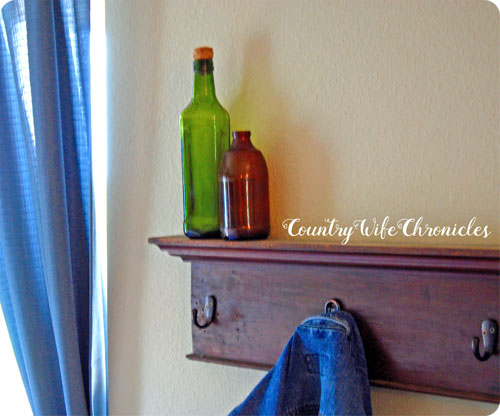 DIY coat rack with bottles on top